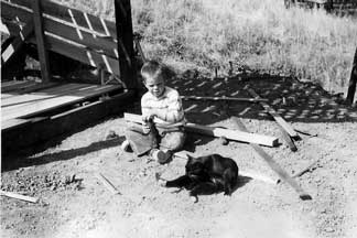 Nickie and our cat at Dad's gazebo, 1951. Click for larger image.