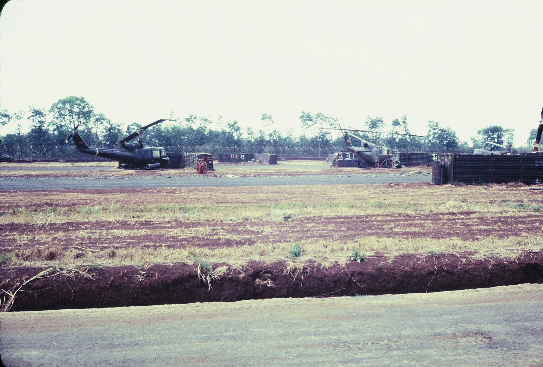 My Pictures-0021.jpg - Some of the gun ship belonging to the 155th assault helicopter company at BMT city strip.