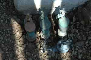 Back row left: the repaired anti-siphon valve. Front: new electric shutoff valve.