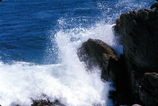 Surf on Rocks - click image for desktop picture